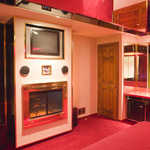 "42"" LCD flat screen TV, AM/FM stereo, fireplace, bubble column lights and wet bar with refrigerator"